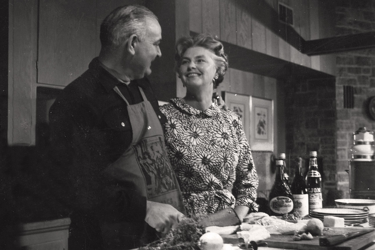 Larry Solari and Polly Solari smile and look at each other while in the kitchen of their Larkmead home